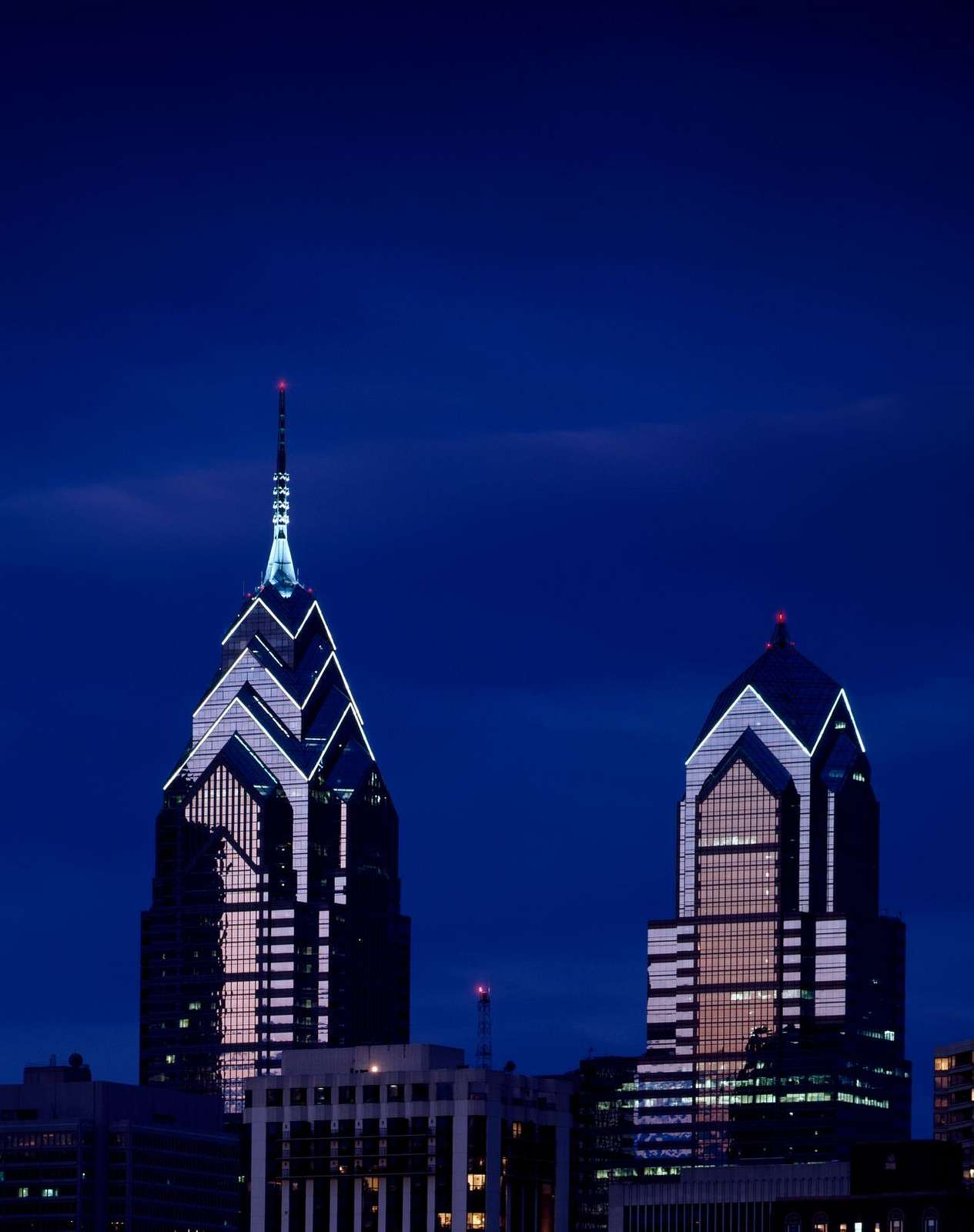 Twin towers of Liberty Place, photographed here at dusk, rose in 1987 and 1990 respectively in Philadelphia, Pennsylvania