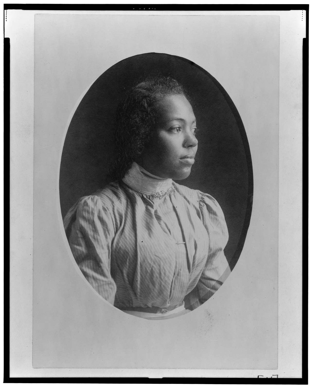 [Young African American woman, half-length portrait, facing right]