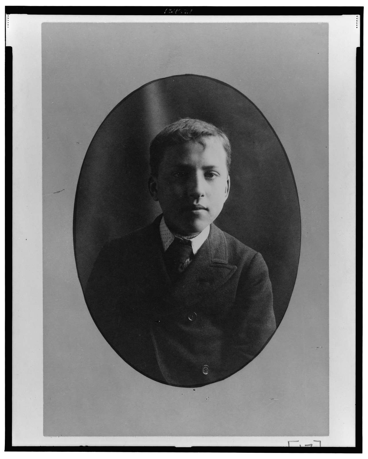[African American boy, head-and-shoulders portrait, facing front]