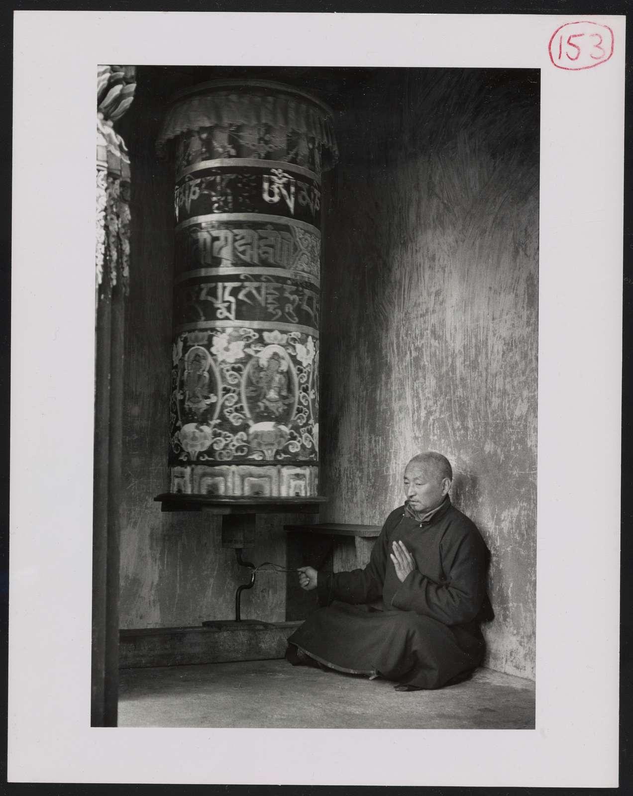 [Shinglay Lama turning giant prayer wheel]
