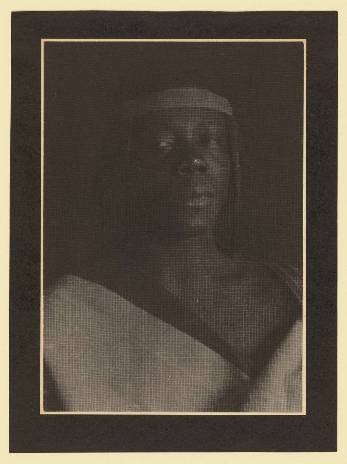 [Young man in African costume with headband]