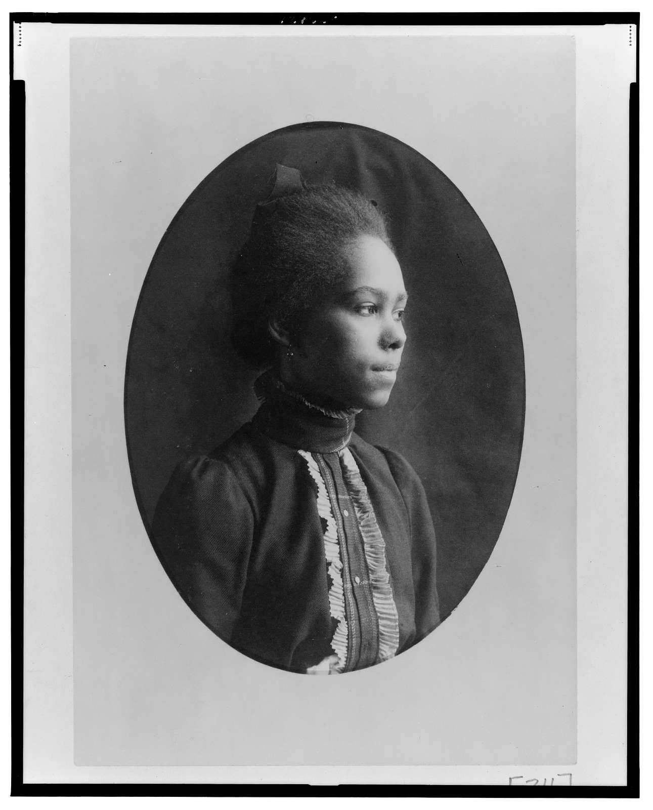 [African American woman, half-length portrait, facing right]