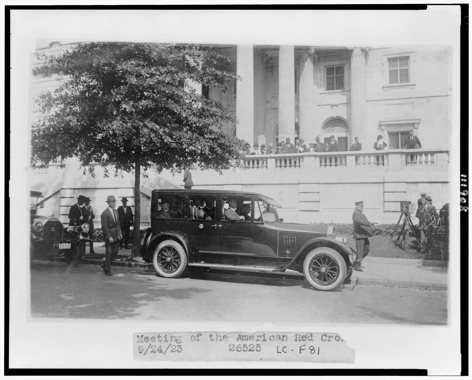 [President Coolidge in automobile at D.A.R. Hall, where he attended a meeting of the American Red Cross]
