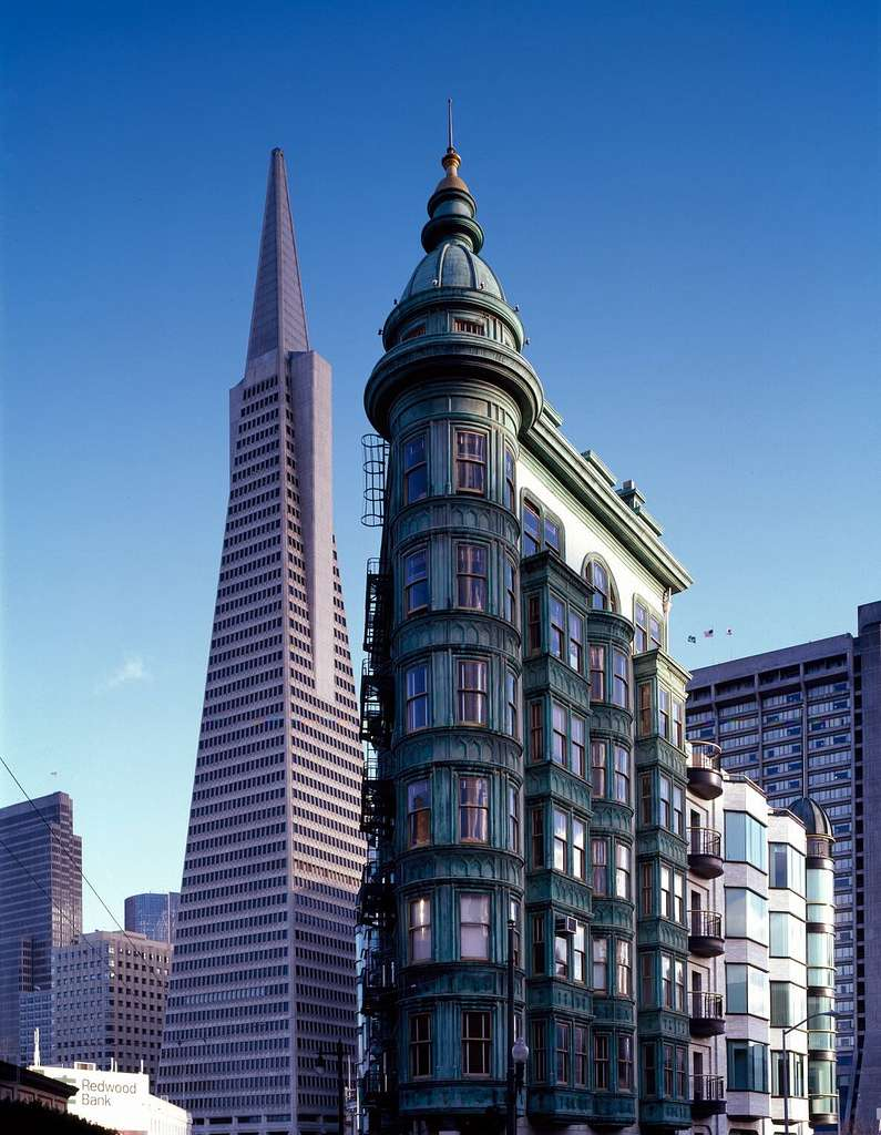 Street-level view of the flatiron Columbus Tower, also called the Sentinel Building, and the Transamerica Pyramid, San Francisco, California
