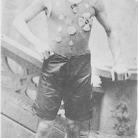 [Ehrich Weiss, full-length portrait, standing, facing front, wearing track team medals, in New York]