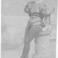 [Beatrice Houdini, full-length portrait, facing front, leaning against pedestal, in 1894]