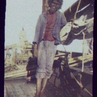 Native crewman on deck of ship