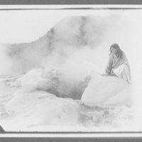 Bella, a Maori guide, sitting at edge of Rotorua geysers