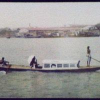 Calcutta - 3 oarsmen pulling long, narrow passenger boat