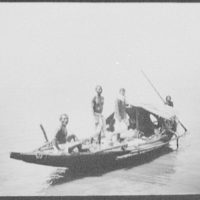 Four men on small Ganges fishing boat
