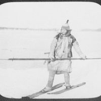 Goldi hunter on skis on ice, holding long spear