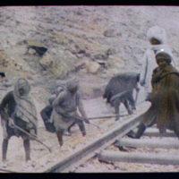Indian workers building railway