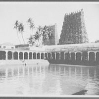 Madura - the bathing tank, showing golden pagoda and south tower of the Temple of Siva