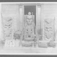 Maori wood carvings, including large and small idols and canoe paddles