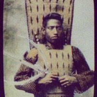 Warrior in ceremonial armor, holding triton