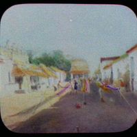 Weaving blankets on street - Madura