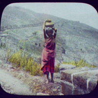 Woman with water jar on head