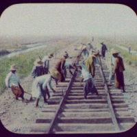 Workmen repairing railroad track