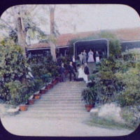 WTC [i.e. World Transportation Commission] and railway officials standing on stairway of private home, Peshawar