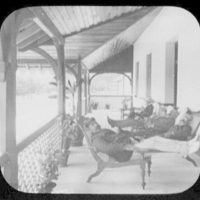 W.T.C. [i.e. World Transportation Commission] in lounge chairs at Banaawela Rest House
