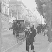 An amah holding a child, Chinatown, San Francisco