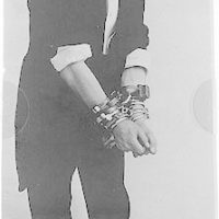 [Harry Houdini, full-length portrait, standing, facing right, in chains]