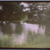 View across a pond of a house