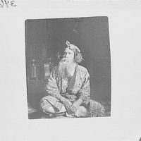 Ainu chief wearing a headdress