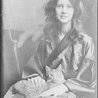 Stebbins, Jocelyn, Miss (Mrs. Fletcher), and Buzzer the cat, portrait photograph