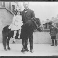 [Houdini with child on pony]