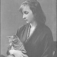 Whittaker, Miss, with Buzzer the cat, portrait photograph