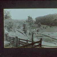 1917-1918, reference prints from negatives. Stream flowing through field with fence in foreground