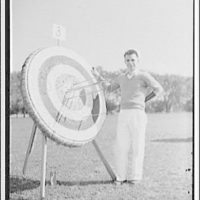 Archers competition. A.L. Taylor of Potomac Archers Association and target on which he scored five bull's-eyes out of six arrows
