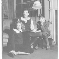 Atcheson children, 2905 P St., N.W. Three children on or around couch I