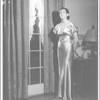 Atcheson children, 2905 P St., N.W. Woman in gown in front of window with curtains II