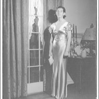 Atcheson children, 2905 P St., N.W. Woman in gown in front of window with curtains IV