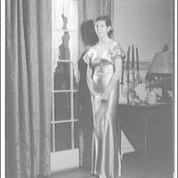 Atcheson children, 2905 P St., N.W. Woman in gown in front of window with curtains III