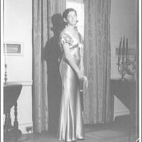 Atcheson children, 2905 P St., N.W. Woman in gown in front of window with curtains I