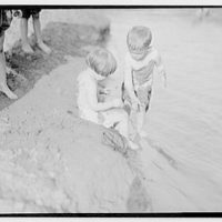 Bathing children in old swimming hole. Two children near bank at swimming hole I