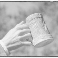 Beer stein. Stein grasped by handle I