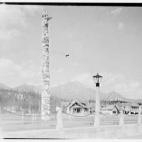 Canadian scenes. Several small buildings with totem pole in foreground I