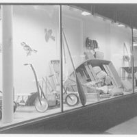 Canadian scenes. Sporting goods store display window with scooter bikes, fishing equipment and other items