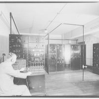 Capitol Radio Engineering Institute. Man in large radio room at Capitol Radio Engineering Institute I