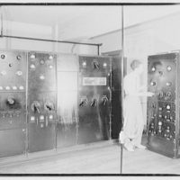 Capitol Radio Engineering Institute. Man standing in radio room at Capitol Radio Engineering Institute