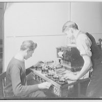 Capitol Radio Engineering Institute. Students examining radio parts at Capitol Radio Engineering Institute I