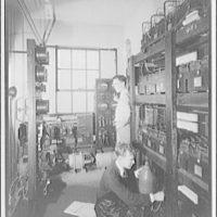 Capitol Radio Engineering Institute. Students in storeroom at Capitol Radio Engineering Institute