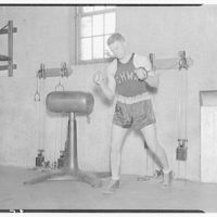Charlotte Hall Military Academy. Boxer training with weights