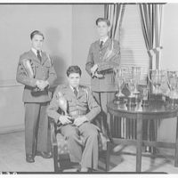 Charlotte Hall Military Academy. Three students with trophies