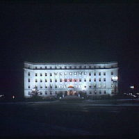 Christmas subjects. Sign on Acacia Mutual Life Insurance Co. Building welcoming World War II soldiers home, night view II