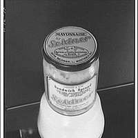 Closures on bottles and jars for glass containers. Mayonnaise in glass jar with lid